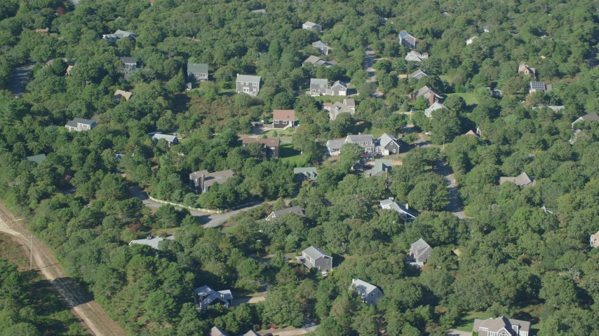 6K stock footage aerial video flying by island homes, forest, Edgartown, Martha's Vineyard, Massachusetts Aerial Stock Footage | AX144_150