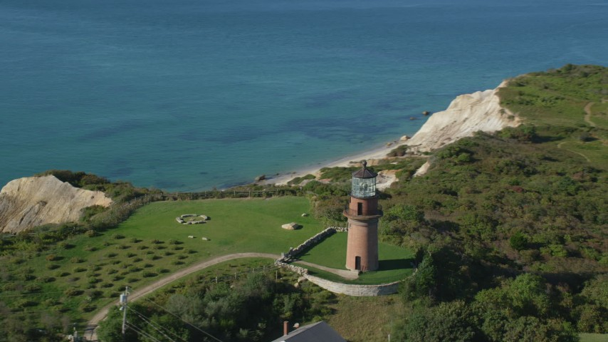 6K stock footage aerial video flying by Gay Head Light, Aquinnah, Martha's Vineyard, Massachusetts Aerial Stock Footage | AX144_166
