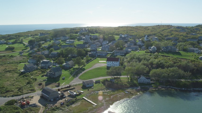 6K stock footage aerial video flying by coastal community, Cuttyhunk Island, Elisabeth Islands, Massachusetts Aerial Stock Footage | AX144_173