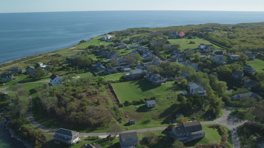 6K stock footage aerial video orbiting coastal community, Cuttyhunk Island, Elisabeth Islands, Massachusetts Aerial Stock Footage | AX144_174