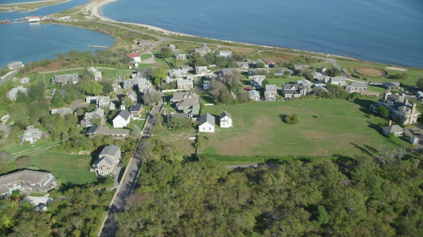 6K stock footage aerial video orbiting coastal community, Cuttyhunk Island, Elisabeth Islands, Massachusetts Aerial Stock Footage | AX144_175