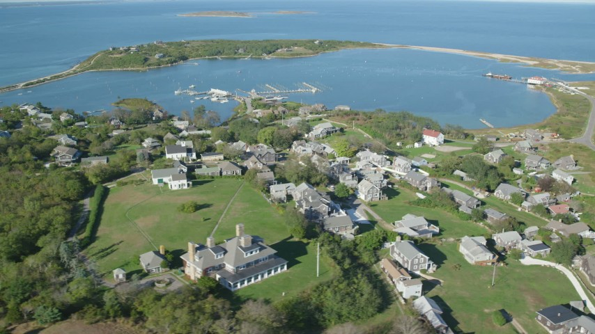 6K stock footage aerial video of a coastal community near pond, Cuttyhunk Island, Elisabeth Islands, Massachusetts Aerial Stock Footage AX144_176 | Axiom Images