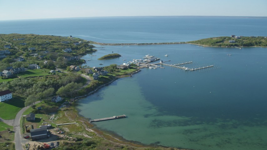 6K stock footage aerial video of a coastal community near pond, Cuttyhunk Island, Elisabeth Islands, Massachusetts Aerial Stock Footage | AX144_177