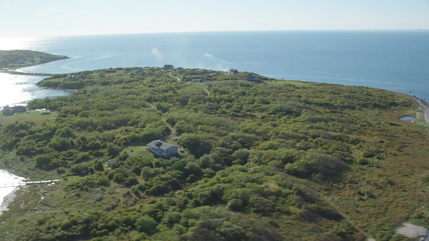 6k stock footage aerial video flying by oceanfront homes, Cuttyhunk Island, Elisabeth Islands, Massachusetts Aerial Stock Footage | AX144_178