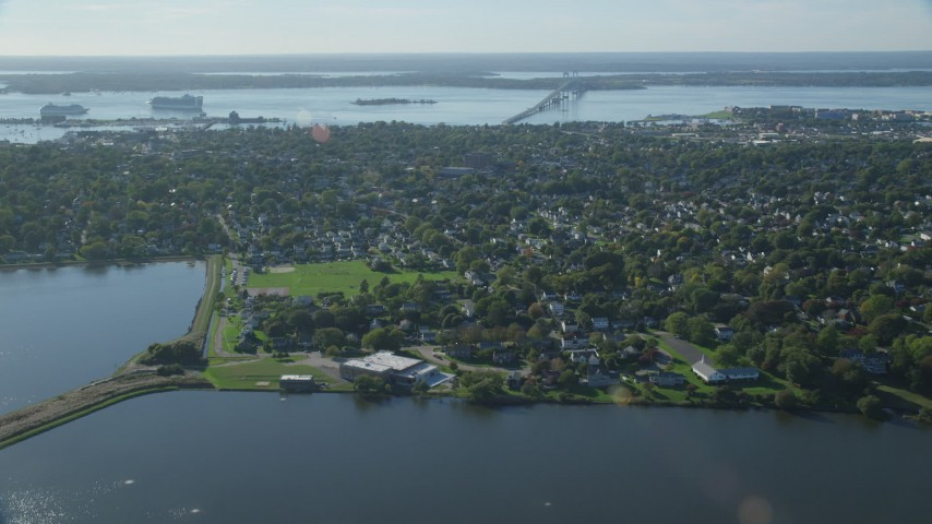 6k stock footage aerial video approaching, fly over coastal community, Newport, Rhode Island Aerial Stock Footage | AX144_226