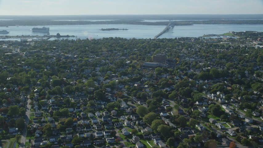 6k stock footage aerial video flying over coastal community, approaching water, Newport, Rhode Island Aerial Stock Footage | AX144_227