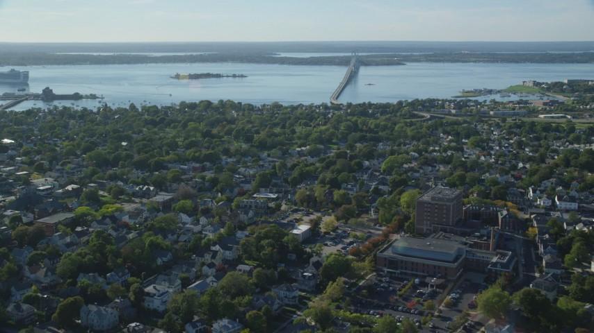 6k stock footage aerial video flying over coastal community, approach Newport Bridge, Newport, Rhode Island Aerial Stock Footage | AX144_228