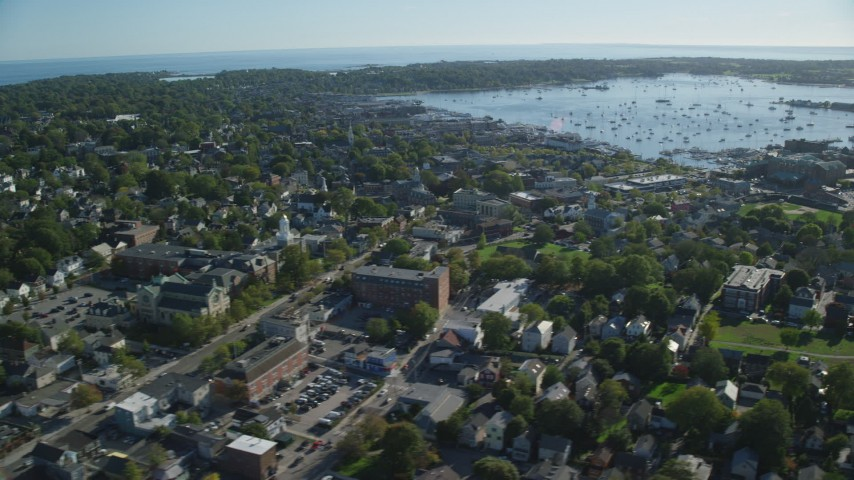 6k stock footage aerial video flying by coastal community, harbor in the distance, Newport, Rhode Island Aerial Stock Footage | AX144_229