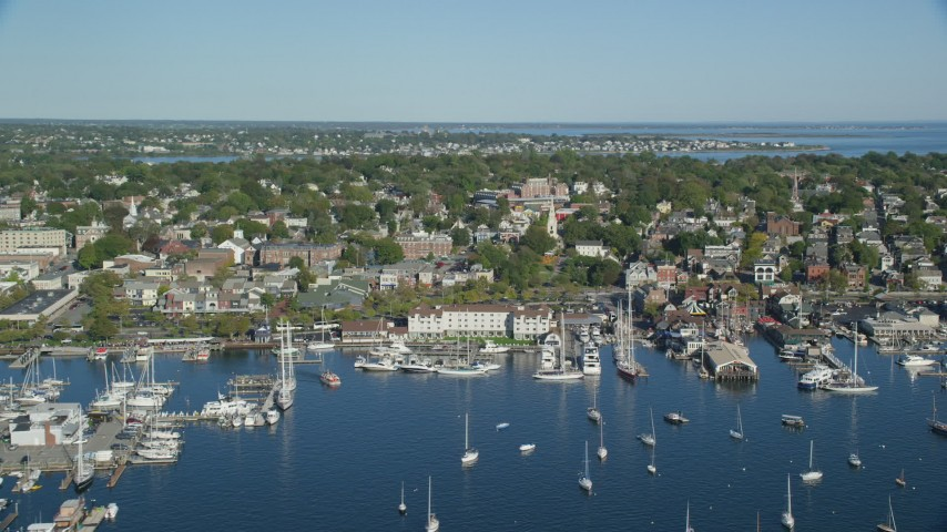 6k stock footage aerial video flying by coastal community, piers, busy harbor, Newport, Rhode Island Aerial Stock Footage | AX144_232