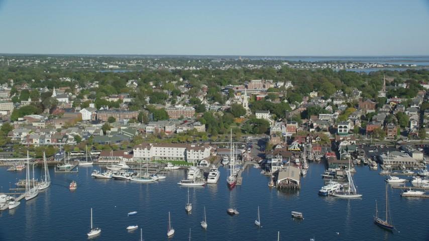 6k stock footage aerial video orbiting coastal community, piers, Newport, Rhode Island Aerial Stock Footage | AX144_233