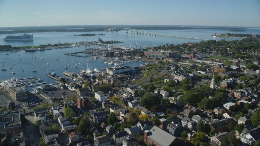 6k stock footage aerial video orbiting coastal community, busy Newport Harbor, Newport, Rhode Island Aerial Stock Footage | AX144_236