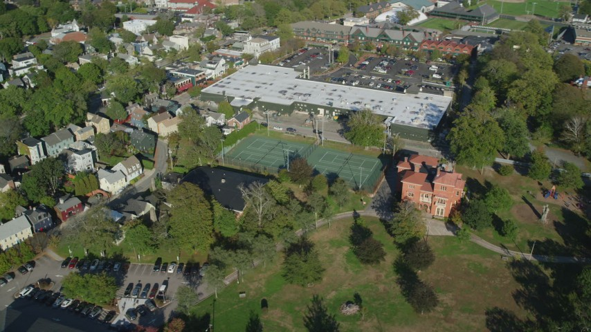 6k stock footage aerial video orbiting strip mall, tennis courts, Edward King House, Newport, Rhode Island Aerial Stock Footage | AX144_241