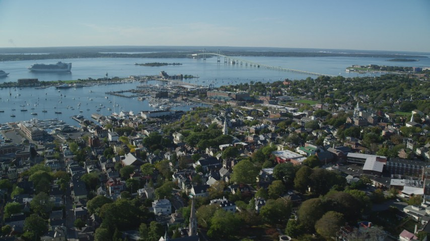 6k stock footage aerial video flying by coastal community, Newport Harbor, Newport, Rhode Island Aerial Stock Footage | AX144_244