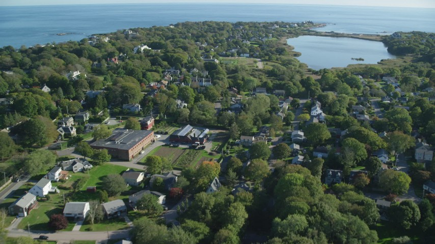 6k stock footage aerial video flying over coastal community, approach Almy Pond, Newport, Rhode Island Aerial Stock Footage   AX144_246
