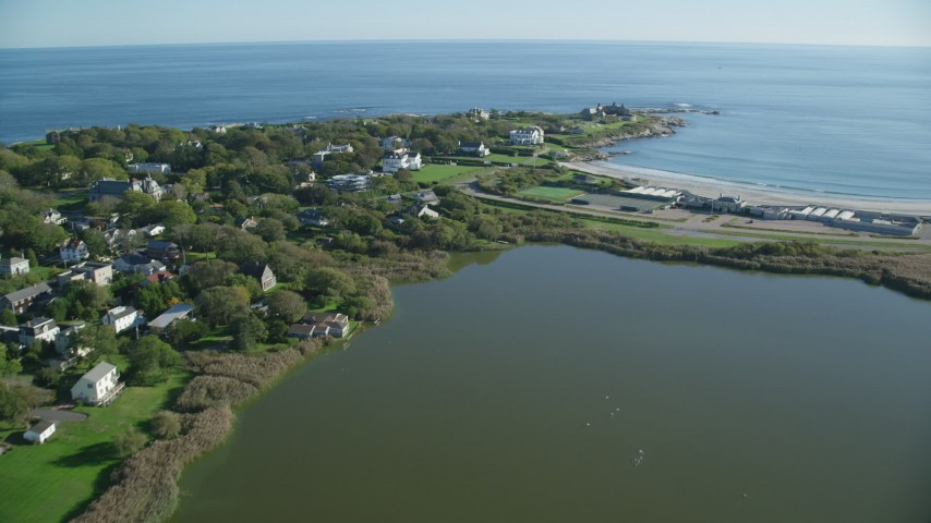 6k stock footage aerial video flying by coastal community, approach oceanfront mansion, Newport, Rhode Island Aerial Stock Footage | AX144_248