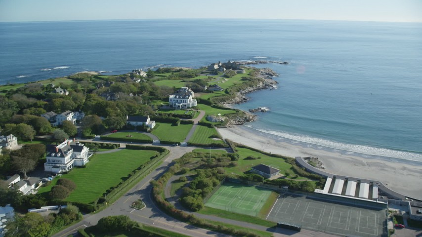 6k stock footage aerial video flying over coastal community, oceanfront mansion, Newport, Rhode Island Aerial Stock Footage | AX144_249