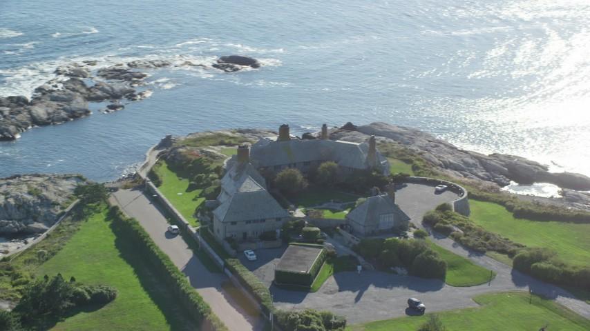 6k stock footage aerial video orbiting oceanfront mansion, coastal cliffs, Newport, Rhode Island Aerial Stock Footage   AX144_250