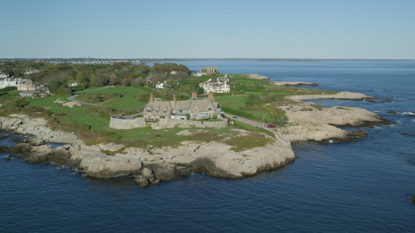6k stock footage aerial video flying by oceanfront mansion, coastal cliffs, Newport, Rhode Island Aerial Stock Footage | AX144_252