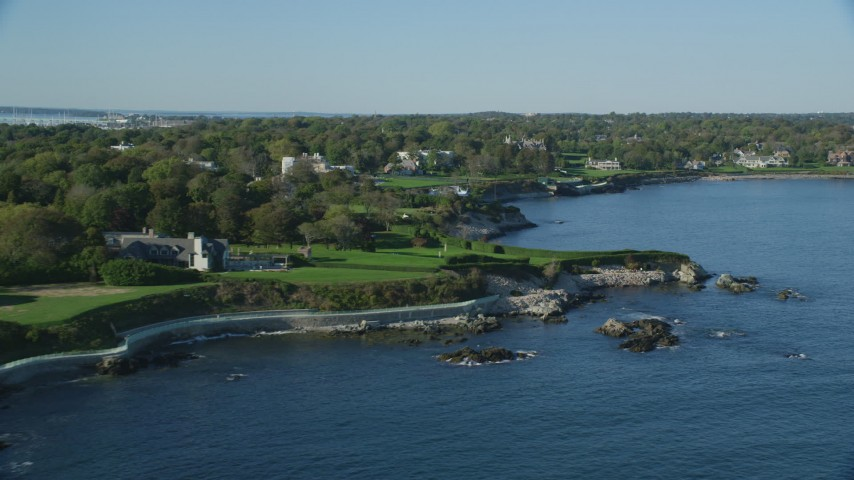 6k stock footage aerial video flying by oceanfront mansion, green lawns, Newport, Rhode Island Aerial Stock Footage | AX144_254