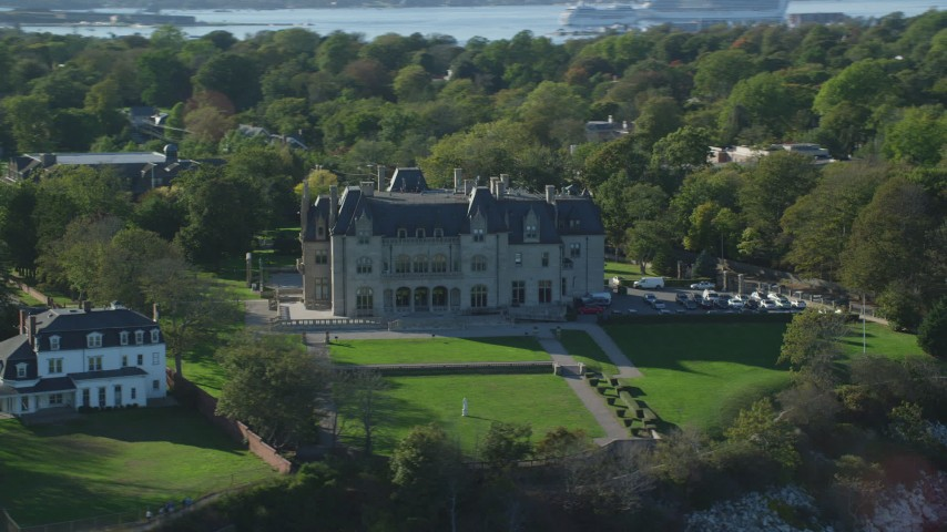 6k stock footage aerial video flying by Ochre Court, oceanfront mansion, Newport, Rhode Island Aerial Stock Footage | AX144_258
