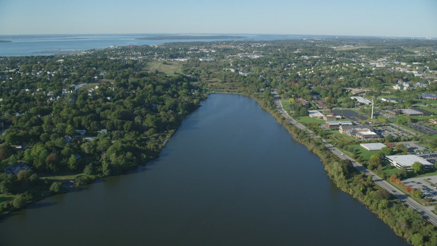 6k stock footage aerial video approaching a coastal community, green trees, Newport, Rhode Island Aerial Stock Footage | AX144_260