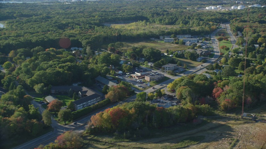 6k stock footage aerial video flying by Wampanoag Trail, small office buildings, Riverside, Rhode Island Aerial Stock Footage | AX145_024