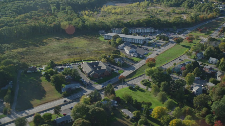6k stock footage aerial video flying by small office buildings, Wampanoag Trail, Riverside, Rhode Island Aerial Stock Footage | AX145_025