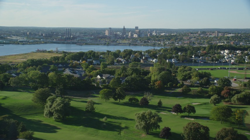6k stock footage aerial video of Metacomet Country Club, approaching Downtown, East Providence, Rhode Island Aerial Stock Footage AX145_030 | Axiom Images