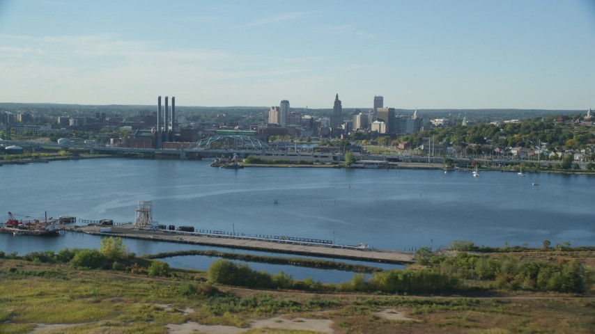 6k stock footage aerial video flying by power plant, smoke stacks and Downtown Providence, Rhode Island Aerial Stock Footage | AX145_031
