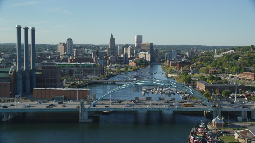6k stock footage aerial video flying over Providence River Bridge, approaching Downtown Providence, Rhode Island Aerial Stock Footage | AX145_033