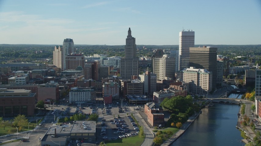 6k stock footage aerial video flying over river, approaching Downtown Providence, Rhode Island Aerial Stock Footage | AX145_035
