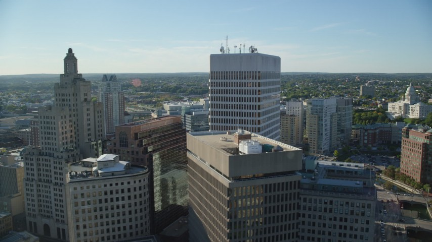 6k stock footage aerial video flying by skyscrapers, revealing buildings, Downtown Providence, Rhode Island Aerial Stock Footage | AX145_037