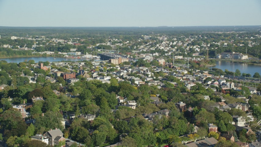 6k stock footage aerial video flying by a residential neighborhood, pan left, Providence, Rhode Island Aerial Stock Footage | AX145_060