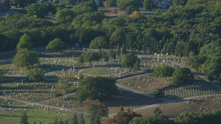 6k stock footage aerial video flying by a cemetery, green trees, Providence, Rhode Island Aerial Stock Footage | AX145_092