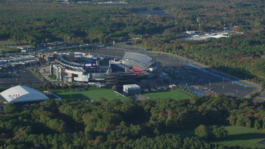 6k stock footage aerial video flying away from Gillette Stadium, trees, autumn, Foxborough, Massachusetts Aerial Stock Footage | AX145_111