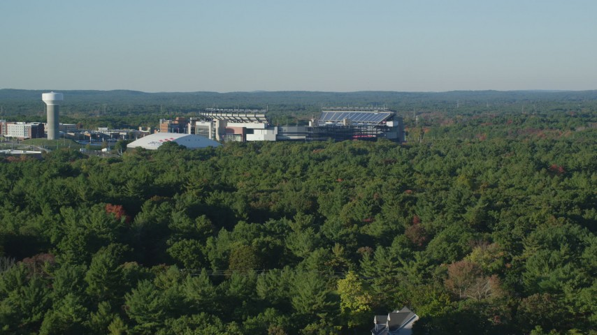 6k stock footage aerial video flying low, approaching Gillette Stadium, autumn, Foxborough, Massachusetts Aerial Stock Footage | AX145_114