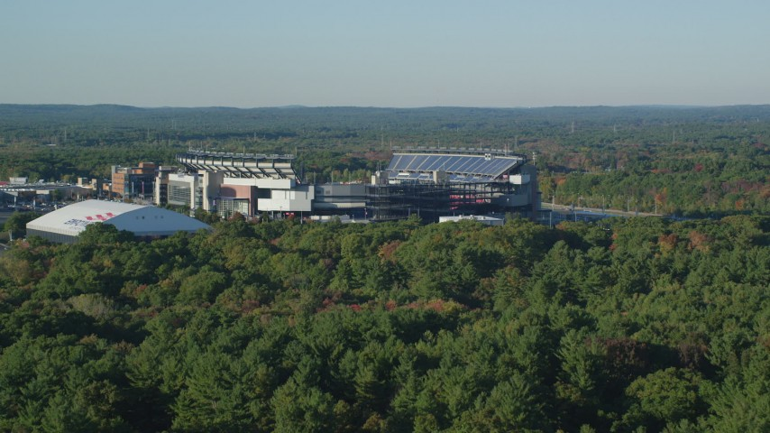 6k stock footage aerial video flying low over trees, approach Gillette Stadium, autumn, Foxborough, Massachusetts Aerial Stock Footage | AX145_115