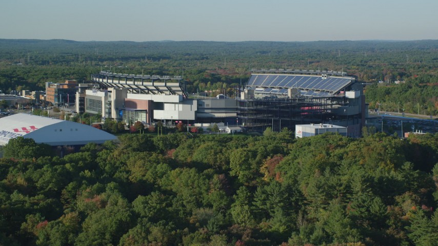 6k stock footage aerial video flying low, approaching Gillette Stadium, autumn, Foxborough, Massachusetts Aerial Stock Footage | AX145_116