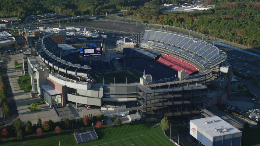 6k stock footage aerial video approaching Gillette Stadium, tilt down, autumn, Foxborough, Massachusetts Aerial Stock Footage | AX145_118