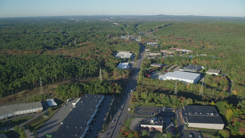 6k stock footage aerial video flying over Boston Providence Highway, warehouses, autumn, Walpole, Massachusetts Aerial Stock Footage | AX145_122