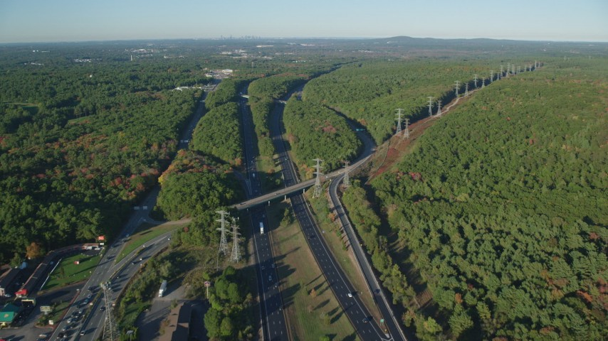 6k stock footage aerial video approaching Interstate 95, deciduous forests, autumn, Walpole, Massachusetts Aerial Stock Footage | AX145_124