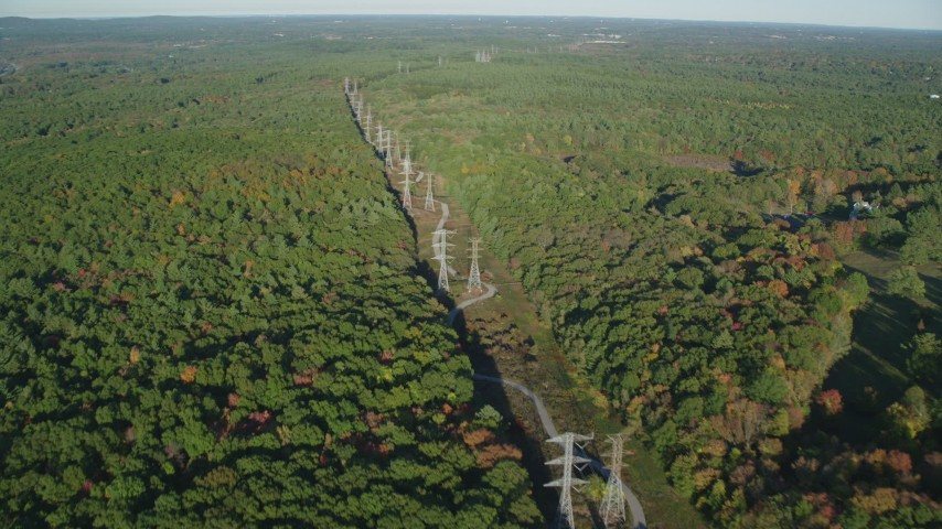 6k stock footage aerial video flying by decision forest, power lines, autumn, Walpole, Massachusetts Aerial Stock Footage | AX145_126