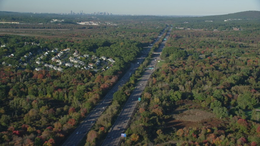 6k stock footage aerial video flying by Interstate 95, colorful trees, autumn, Norwood, Massachusetts Aerial Stock Footage | AX145_128