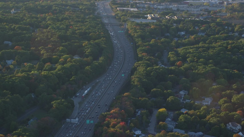 6k stock footage aerial video flying by interstate 93, heavy traffic, autumn, Westwood, Massachusetts, sunset Aerial Stock Footage | AX146_004