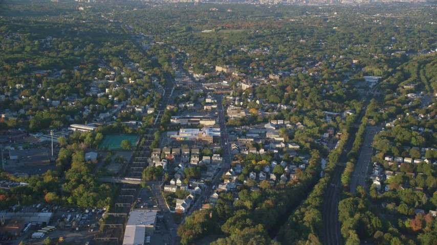 6k stock footage aerial video flying over Hyde Park Avenue, autumn, Hyde Park, Massachusetts, sunset Aerial Stock Footage   AX146_006