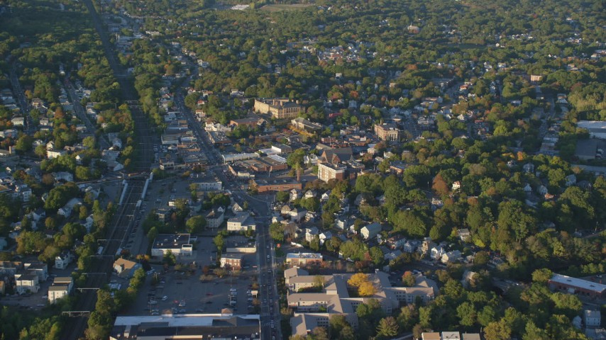 6k stock footage aerial video flying over a residential neighborhood, autumn, Hyde Park, Massachusetts, sunset Aerial Stock Footage | AX146_007