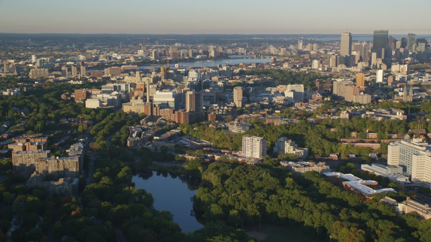 6k stock footage aerial video of Longwood Medical Area, reveal skyline, Downtown Boston, Massachusetts, sunset Aerial Stock Footage | AX146_012