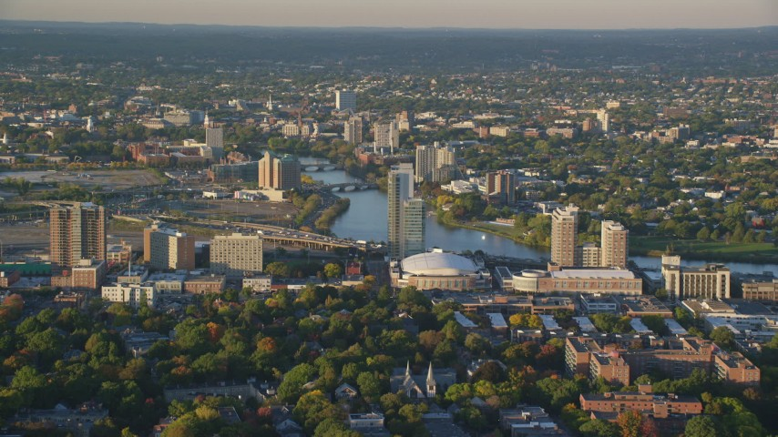 6k stock footage aerial video approaching Agganis Arena, apartments, Charles River, Boston, Massachusetts, sunset Aerial Stock Footage | AX146_014