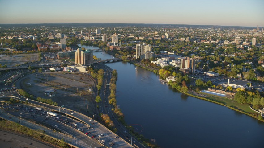 6k stock footage aerial video approaching bridges spanning Charles River, Cambridge, Massachusetts, sunset Aerial Stock Footage | AX146_016