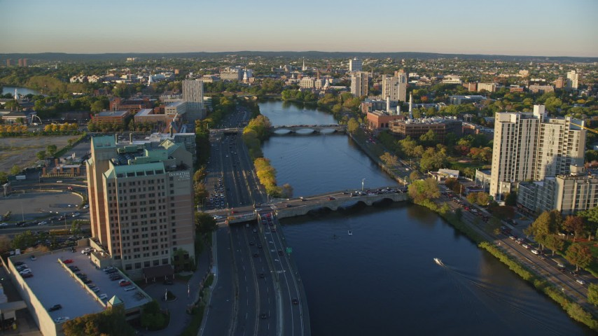 6k stock footage aerial video approaching bridges spanning the Charles River, Cambridge, Massachusetts, sunset Aerial Stock Footage | AX146_017